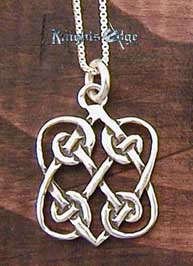 "Sterling Silver Celtic Love Knot. Two Hearts entwined in silver celtic knots. 5/8"" wide"