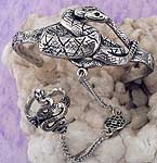 The medusa snake slave bracelet is made of lead-free pewter. One size fits all. The bracelet is adjustable.