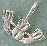 "Claddagh charm pendant. The tradition of wearing charms dates back to medieval times. Objects were frequently worn from a cord or chain about the neck so they would not be lost. 3/4""W."