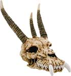 "Possess the ancient dragon skull of the most powerful creature of medieval lore! The dragon skull is cast in resin and detailed to a very old and realistic finish. For table or wall mount. 8"" H."