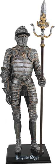 "Italian ""Milanese"" knight figure in armour complete with polearm weapon. This medieval knight is expertly cast in resin. The figurine has antique pewter finish and is hand detailed with striking gold accents."