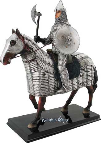 "Attired for battle, our Norman knight figurine upon his mighty steed awaits the call for battle. Beautifully crafted in resin and individually hand detailed in spectacular vibrant and metallic colors. 10-1/2"" Tall."